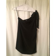Olive Olivia black one-shoulder shift dress This black silky dress ties in a big fun bow on the shoulder. Loose fitting and comfortable. Worn only once. Dresses One Shoulder