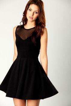 Little black dress. Sheer cut at top