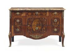 A LOUIS XVI ORMOLU-MOUNTED TULIPWOOD AND MARQUETRY COMMODE BY MARTIN OHNEBERG, CIRCA 1775