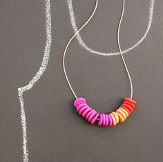 not quite flat beads make a necklace by notTuesday on Etsy, $45.00