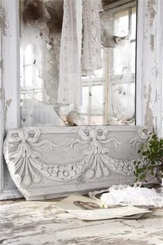 great idea on how you could repurpose an old piece of antique wooden furniture, so pretty in white mixed with antique laces....