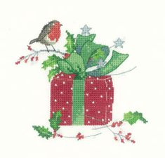 "Christmas Gift (SCCG1106) Christmas cross stitch kit based on the artwork of Sue Hill, produced by Heritage Crafts. Contents: 14 count aida or 27 count evenweave fabric, DMC stranded cotton threads, needle, chart and full instructions. Size: approx. 4"" x 5"" DELIVERY DETAILS: - Please allow upto 7 working days for dispatch."