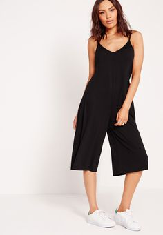 Don't pay extra dollar for your wardrobe necessities. This basic culotte jumpsuit will inject some life into your day game style! In an always on trend black, jersey material and sexy plunge neckline, this will take you from day to night. T...