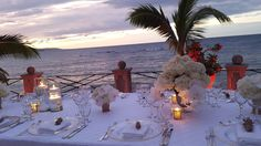 Soft candlelight adds just enough glow to this seaside reception at Round Hill Hotel & Villas in Montego Bay, Jamaica.