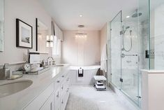 clean white bathroom with crystal chandelier
