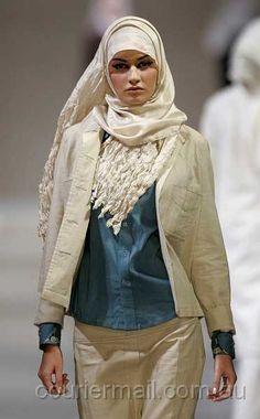 Hijabi Fashion:  Teal blouse with beige jacket and skirt  from The Islamic Fashion Festival during Malaysia International Fashion Week in Kuala Lumpur. Designer Roxana Mariam.