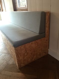 Self-made cheap-ass OSB kitchen couch bench in our kitchen