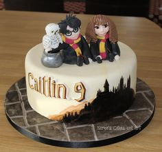 Harry Potter, Hermione and Hedwig cake, flagstone board and a painted Hogwarts. https://www.facebook.com/karenscakesandart