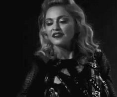 Madonna mouthing 'i love you too' and giving an air kiss to her fans during the MDNA Tour, 2012