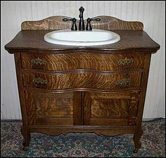 Photo of Front View - Antique Bathroom Vanity: Antique Oak Washstand with sink and bronze faucet