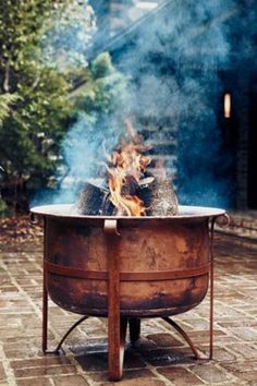 What a BEAUTIFUL, cauldron-like, fire pit. Adore it!