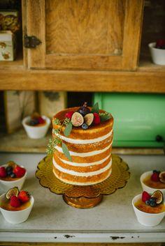 naked wedding cake, photo by Ashlee Hamon Photography http://ruffledblog.com/amelie-inspired-wedding-ideas #weddingcake #cakes