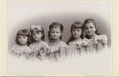 Antique Victorian cabinet card photo of five sisters. Each one is gorgeous and dressed in the lovely fashion of the times.