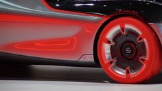 Opel debuted the GT Concept at the 2016 Geneva Motor Show. This stunning, super-lightweight coupé combines gorgeously futuristic design (from the tiny front and rear overhangs shifting focus to the two-seat cockpit, to the hot red tires on the front wheels) with styling cues harking back to classic Opels of the past. Geneva Motor Show, Futuristic Design, Motors, Two By Two, Wheels, Concept, Classic, Hot, Cutaway