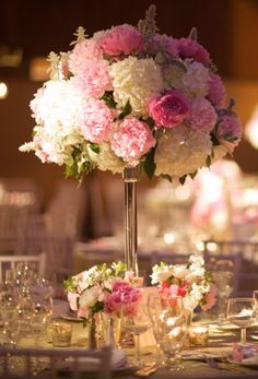 Elegant guest centerpiece designed with white hydrangea, pink peonies and blooming lambs ear.