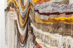 Peruvian artist Ana Teresa Barboza has previously been drawn to recreating full landscapes with yarn and thread, embroidering large tapestries with rivers, valleys, and waves that spill out from the wall and rest on the floor.