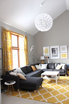 / sherwin williams mindful gray + tall ceilings! I love this couch but I'm not a fan of the yellow accent pieces! I think it would look a lot better with cooler colors!, gray yellow decor design