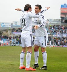 Gareth Bale of Real Madrid celebrates with Cristiano Ronaldo after scoring his team's 2nd goal during the La Liga match between Getafe CF and Real Madrid CF at Coliseum Alfonso Pérez on January 18, 2015 in Getafe, Spain.