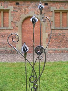 Blacksmith made Cala Lilies & Wiggle Stems by Adrian The Smith at Trinity Forge, via Flickr