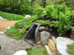 Natural playscaping. I especially like the little cubby/cave for hiding in.