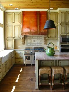 Love the wood ceiling, green teapot, cupboard fronts... everything about this kitchen.