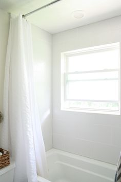 When redoing a bath, tile all the way up to the ceiling in the shower/tub, and hang long curtain all the way up to the ceiling (instead of traditional lower height). AE.   master bath after 2