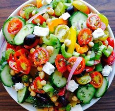 cherry tomatoes, cucumber, orange and yellow bell peppers,celery, red onion, kalamata olives, chickpeas, feta, some kind of herbs...