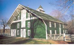 Builders extended the roof line several feet to provide protection for the main doorway. This green barn is located in Clay County, Indiana, near the Clay-Putnam County line.
