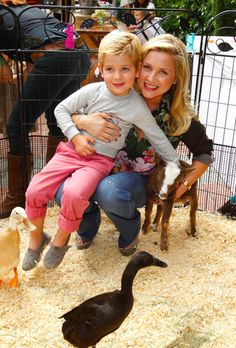 Jessica capshaw and son in petting zoo