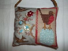 Bent Creek Robin on egg with Moda fabric, MOP button nests (from my childhood clothing) and bead eggs.