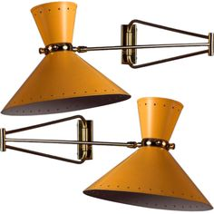 Pierre Guariche articulated wall lights with enameled metal shades
