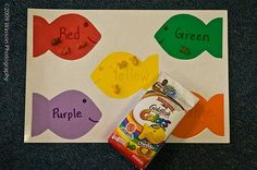 sorting w/ colored goldfish. For articulation therapy, place a targeted word/ picture on each fish. The child says the word each time she places a cracker on it!