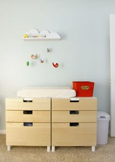 Changing table - Hang stuff from the upper shelf to distract baby while changing