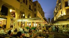 Lebanese food is more than falafel and kebabs. A row of outdoor restaurants in Beirut. Packed with family-style restaurants and street stalls, the capital is a good place to start.