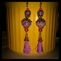Tassels purples, gold, n orange dangles Beautiful Bali wood style Tassel Earart =)  All made of high quality beads and materials! Always Handmade By me with a ton of Love ? All 1 of a kind designs! Can and will work with you for custom requests!  #uniqueisgreat!  #1ofakinddesigns  #Onlyuwillhave! ! ! ! ! ! ! ! ! ! ! ! ! ! ! Mine  Jewelry Earrings