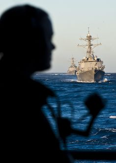 A Sailor stands aft watch aboard USS Nimtz. by Official U.S. Navy Imagery, via Flickr