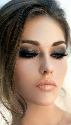 Black & silver smokey eyes with golden pink lips... all with flawless foundation, highlighting, & a heavy brow.