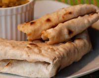 Roti is a West-Indian style grilled flatbread that is popular in Suriame, Guyana, and French Guiana for a South American classic like no other. Grilled Flatbread, Flatbread Recipes, Carribean Food, Caribbean Recipes, Indian Food Recipes, Ethnic Recipes, Indian Foods, Indian Dishes, Indian Kitchen