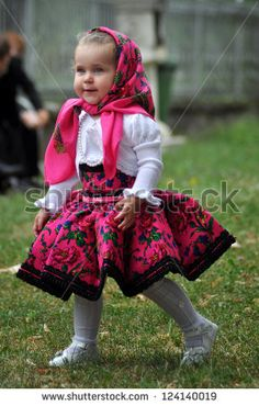 Unidentified villager child in traditional dress celebrate a traditional Romanian wedding on JULY 12, 2012, in Gherta Mica, Maramures, Romania