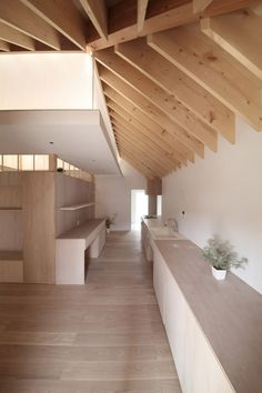 Exposed ceiling beams creating a captivating pattern and design element. Wengawa House by Katsutoshi Sasaki