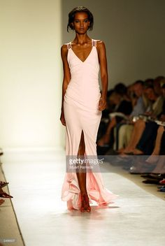 A model walks the runway at the Carolina Herrera Spring/Summer 2004 fashion show at Bryant Park during the 7th on Sixth Mercedes-Benz New York Fashion Week on September 15, 2003 in New York City.