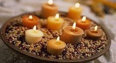 Velas para decorar la casa: fotos de algunas ideas originales - Decoración con velas: velas de té sobre piedras en centro de mesa