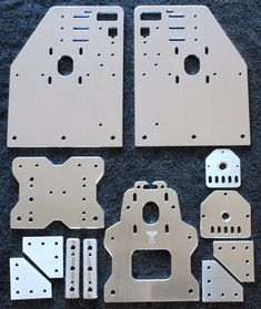 A set of four Gantry Plates for the OX CNC machine, spacer blocks, a set of Universal Threaded Rod Plates so you can use either a Nema 23 or Nema 17 on the Z axis. (The X plate and Spacer blocks can also be used with only 3 wheels) and joiners. Cnc Plasma Table, Cnc Table, Lamp Table, Router Table, Diy Cnc Router, Cardboard Playhouse, Cardboard Crafts, Cardboard Tubes, Diy Wooden Projects