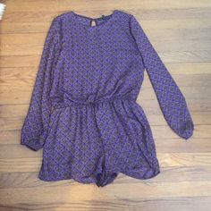 Printed long sleeve romper Purple and blue with an open back and high neckline. Cinched elastic waist pairs perfectly with a belt. Lucca Couture Other