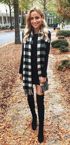 #winter #outfits black long-sleeved mini dress, pair of thigh-high boots, and checked fringe scarf outfit