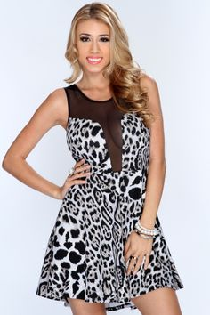 Make your way in this roaring sexy party dress! Fashionable and chic as you stroll down the street or waltz your way into any party or night club! This stylish beastly outfit with definitely be the eye catcher of the night. Featuring scoop neckline, mesh cutout, sleeveless, leopard print throughout, and finished with a flowy loose fit. 95% polyester 5% spandex. Made in USA