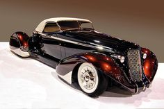 36 Auburn Roadster  Custom Roadster with pontoon fenders  Owner: James Hetfield, Carlsbad, CA  Black & Root Beer  James is the lead singer of Metallica.  He calls this car Slow Burn