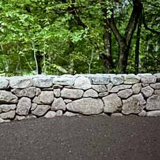 How to Build a fieldstone wall - something to do with all the rocks on the property