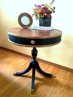 Black and Gold Duncan Phyfe Drum Table by ChairishedFurnishing