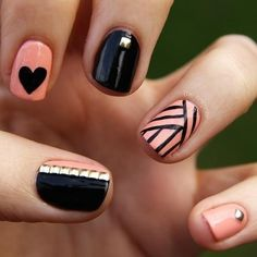 Pink  Black nails with a Stripe  Heart designs,  Silver Studded accents.